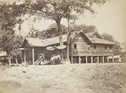 Mandalay. S.P.G. Mission School, built by the king, under the superintendence of the Revd. J.E. Marks. Four of the King's sons, are in the foreground under a canopy of golden umbrellas.